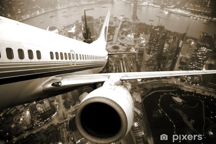 Fototapeta winylowa Start samolotu nad miastem -