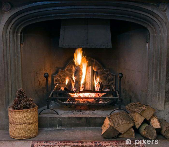 Fototapeta winylowa Kamienny kominek z zapaloną ryk ognia - iStaging
