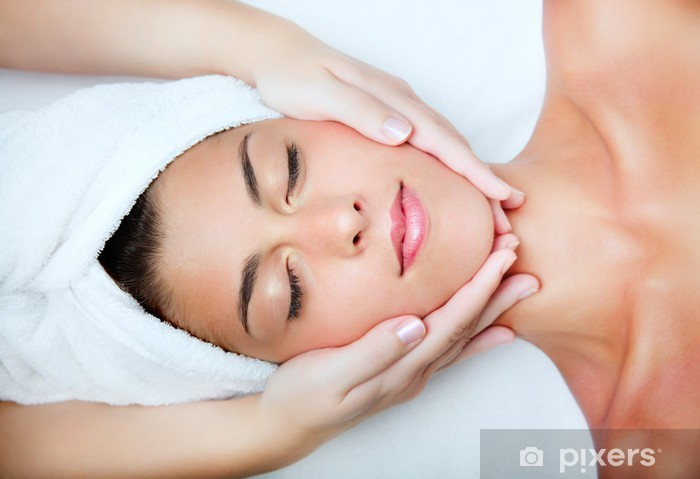 Beautiful young woman receiving facial massage. Vinyl Wall Mural - Health