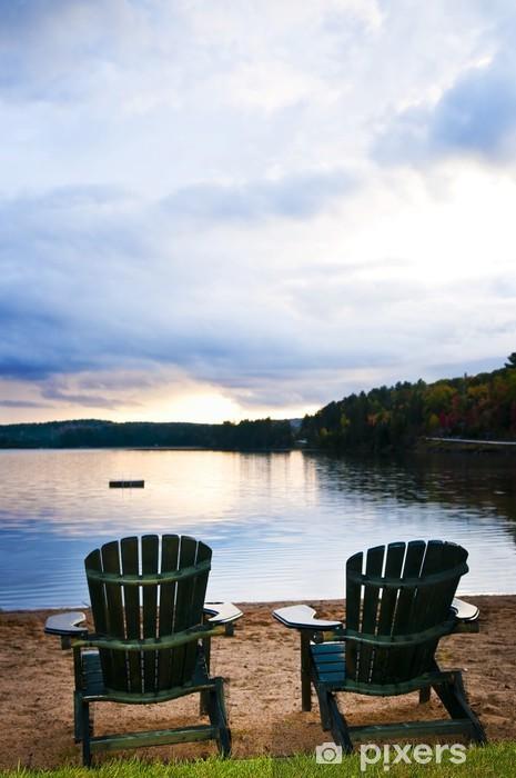 Wooden chairs at sunset on beach Pixerstick Sticker - Water