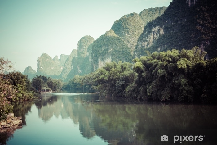 Scenic view of Yulong River among green woods and karst mountains at Yangshuo County of Guilin, China. Yangshuo is a popular tourist destination of Asia. Vinyl Wall Mural - Landscapes