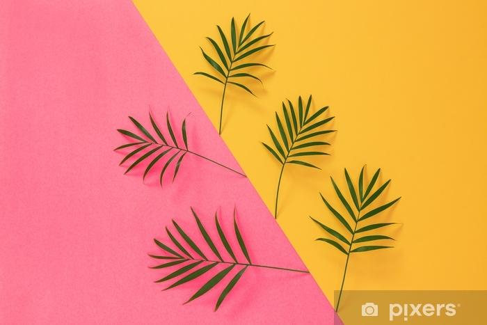 Naklejka Pixerstick Liści palmowych na żywe różowe i żółte tło - Rośliny i kwiaty
