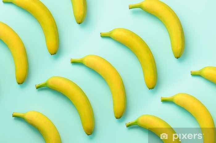 Colorful fruit pattern. Bananas over blue background. Top view. Pop art design, creative summer concept. Minimal flat lay style. Pixerstick Sticker - Food