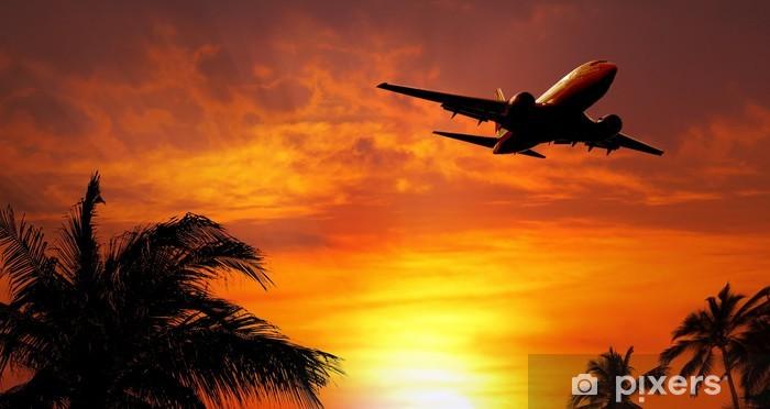 Sticker Pixerstick Avion au coucher du soleil - Dans les airs