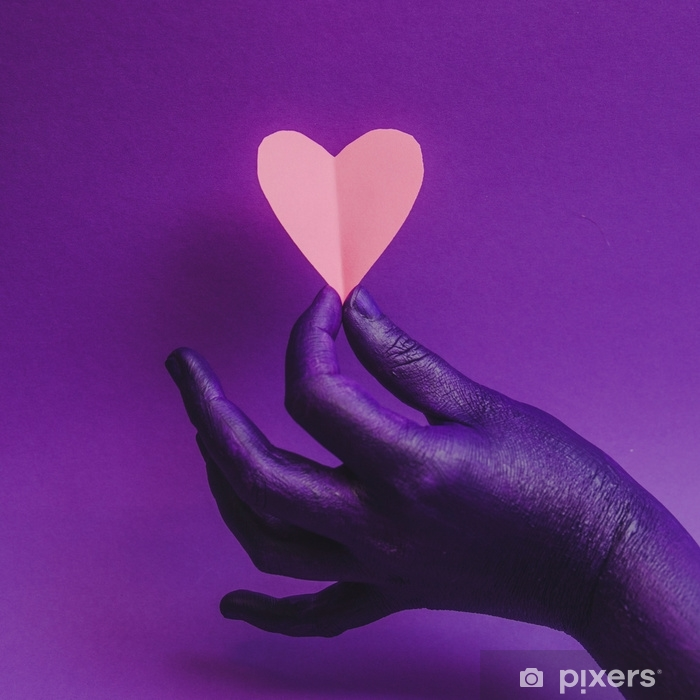 Female hand, showing beauty and skin care symbolism. Holding paper craft pink heart. fashion background, purple neon colors. Minimalism . Self-Adhesive Wall Mural - People