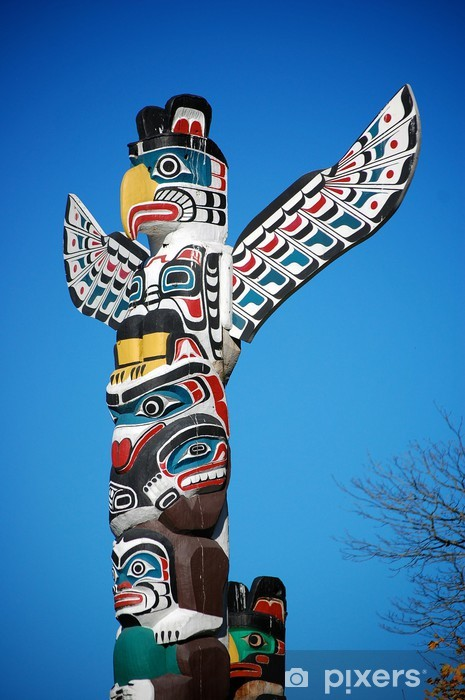 A colorful totem pole in Stanley Park, Vancouver. Wall Mural Vinyl