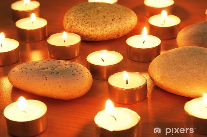 Fototapeta winylowa Nagrywanie świece i kamyki na sesji aromaterapii - PI-31