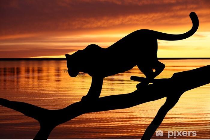 Fototapeta winylowa Sylwetka lampart na gałęzi na tle zachodu słońca - Tematy