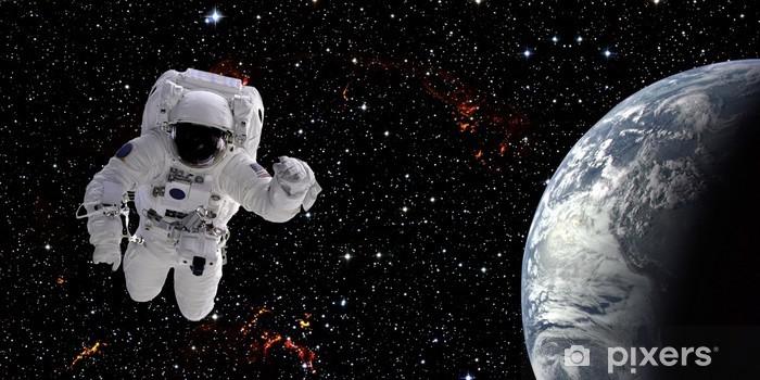 Naklejka Pixerstick Astronauta w kosmosie - Przestrzeń kosmiczna