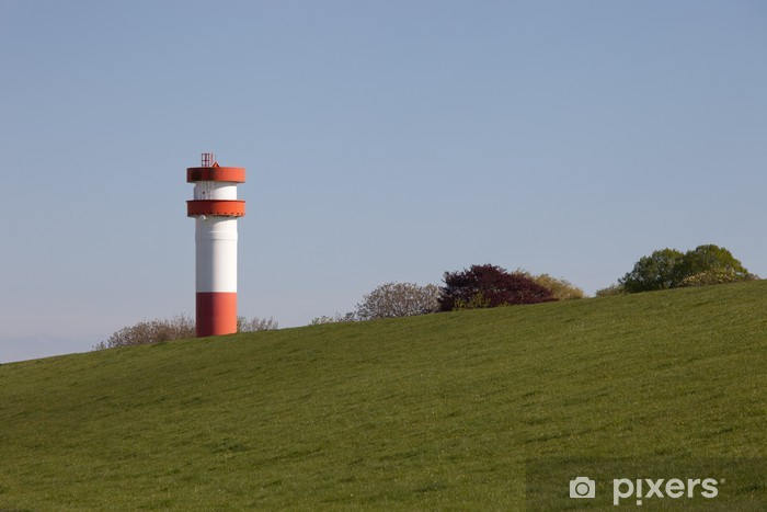 Fototapeta winylowa Lighthouse Under Fire, Krautsand - Wakacje