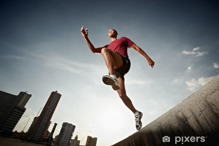 Naklejka Pixerstick Hiszpanie człowiek bieganie i skakanie od ściany - Tematy