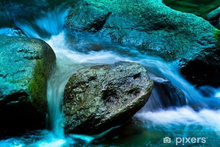 Fototapeta winylowa Creek z wody i kamieni w górach - Criteo