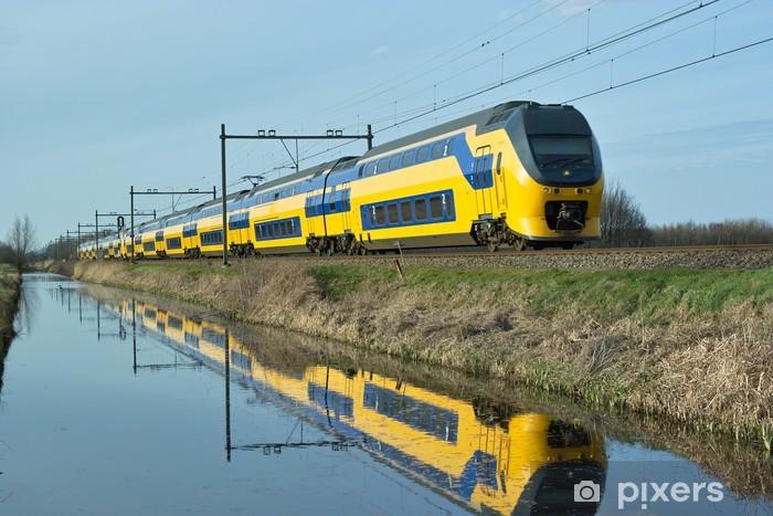 Dutch train en route along canal Vinyl Wall Mural - Europe