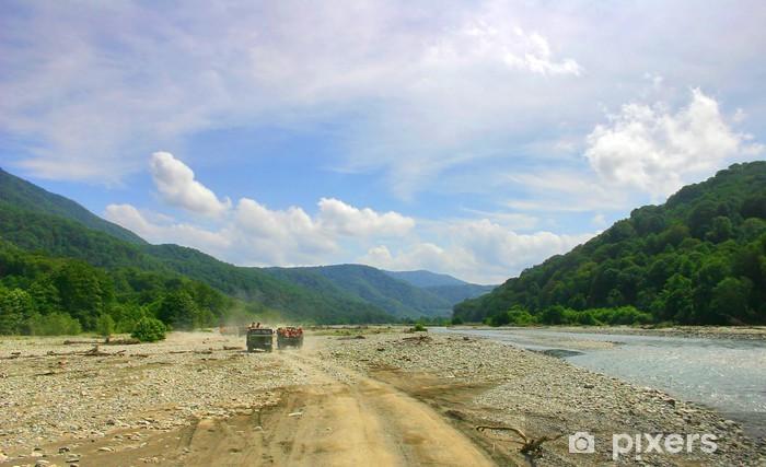 Fototapeta winylowa Pejzaż z gór, droga, niebo i rzeka - Góry