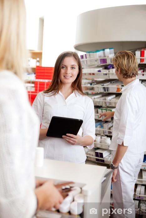Vinyl-Fototapete Female Pharmacist Holding Tablet PC - Berufe