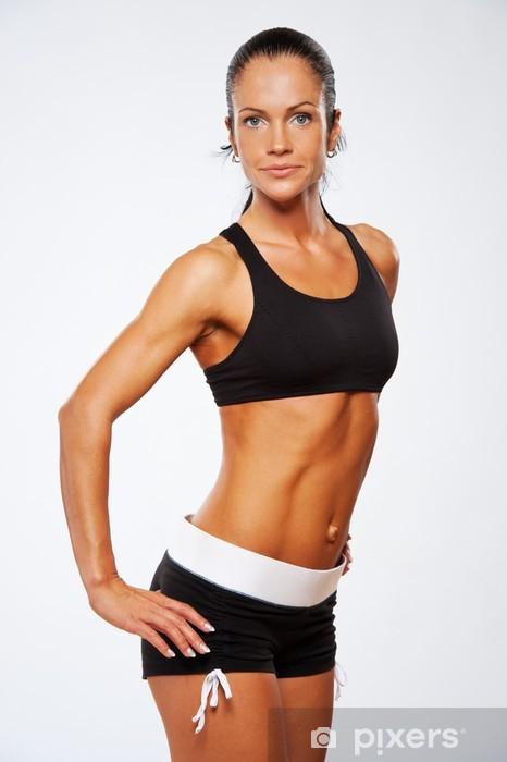 Sticker Pixerstick Belle femme d'athlète faisant l'exercice de remise en forme. - Femmes