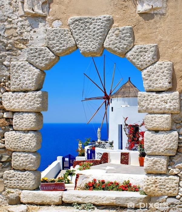 Pixerstick Sticker Windmolen door een oud venster in Santorini, Griekenland - Santorini