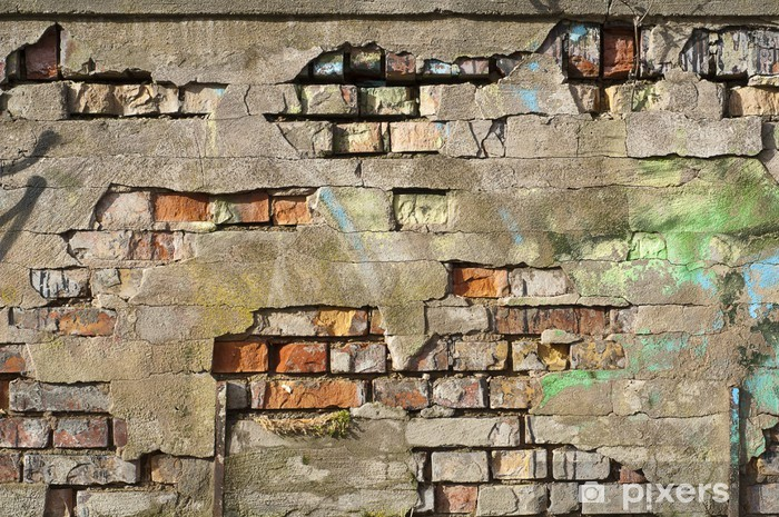 Fototapeta winylowa Stary mur z pęknięć i graffiti - Tła