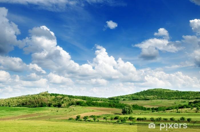 Naklejka Pixerstick Górzysty teren i błękitne niebo. - Niebo