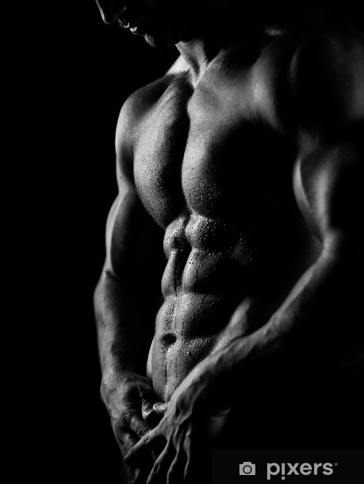 Fotomural Estándar Hombre fuerte de atlética sobre fondo oscuro -