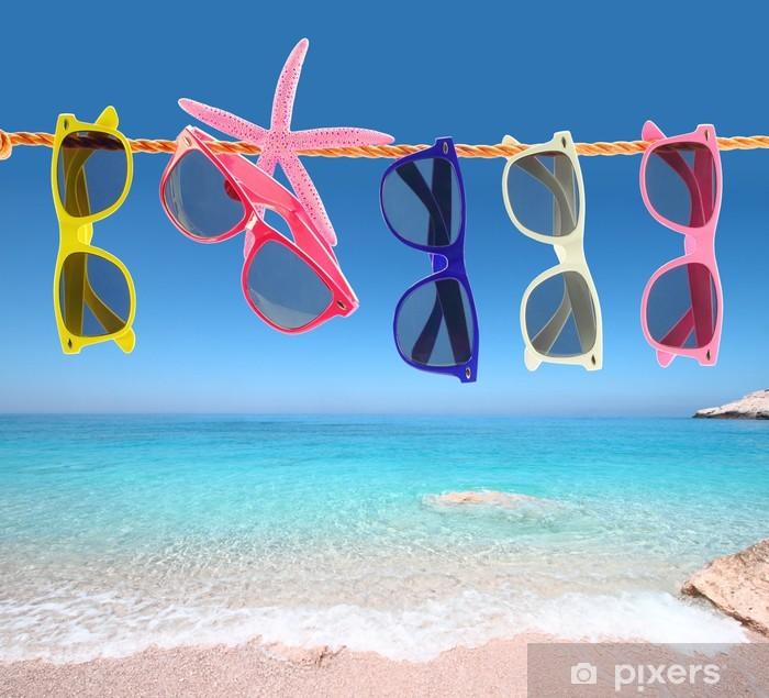 20f769b5cec4 Collection of sunglasses on the beach Pixerstick Sticker - Health and  Medicine