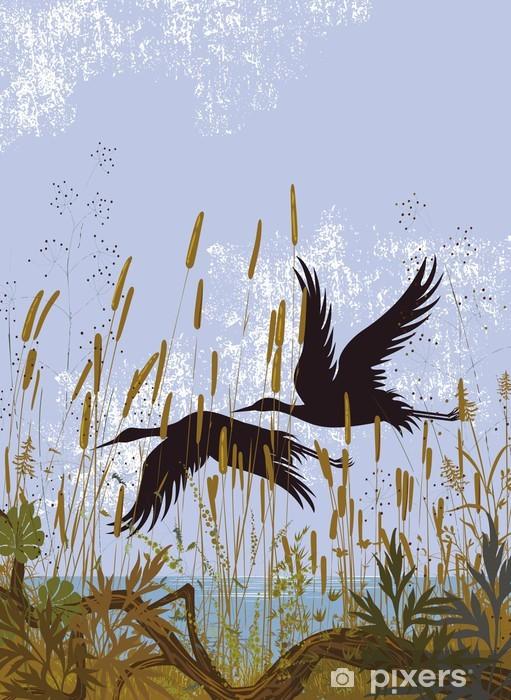 Fototapeta winylowa Sylwetki dwóch ptaków latających nad jeziorem -