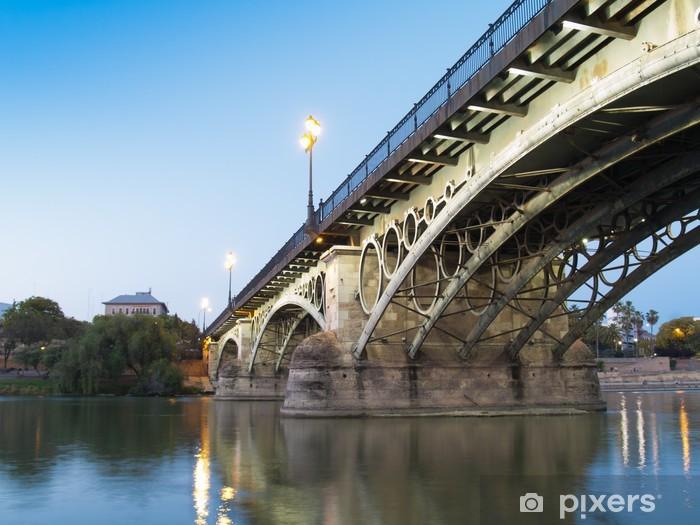 Nálepka Pixerstick Triana most, nejstarší most v Seville za soumraku - Evropa