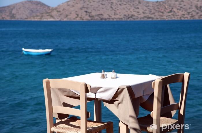 Fototapeta winylowa Tradycyjne greckie zewnątrz restauracji (Kreta, Grecja)). - Wyspy