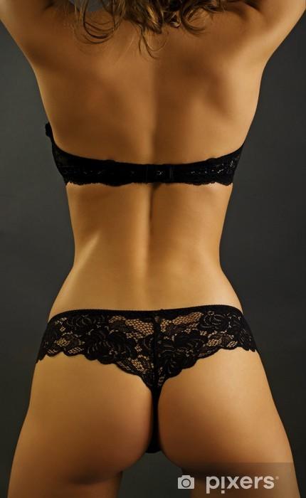 Blonde En Lingerie sexy back of young beautiful blonde in lingerie over dark backgr