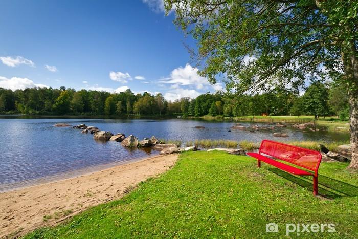 Fototapeta winylowa Czerwona Ławka na jeziorze w Kyrkhult, Szwecja - Europa