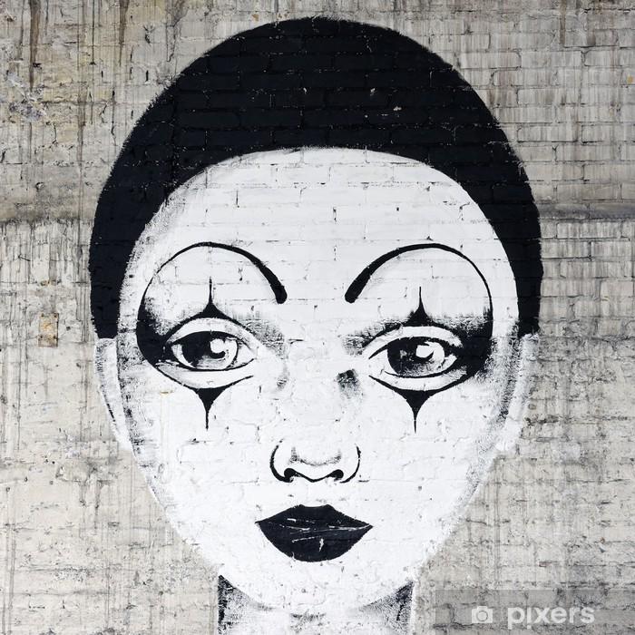 Papier peint vinyle Blanc de clown au visage graffiti sur un mur de brique -