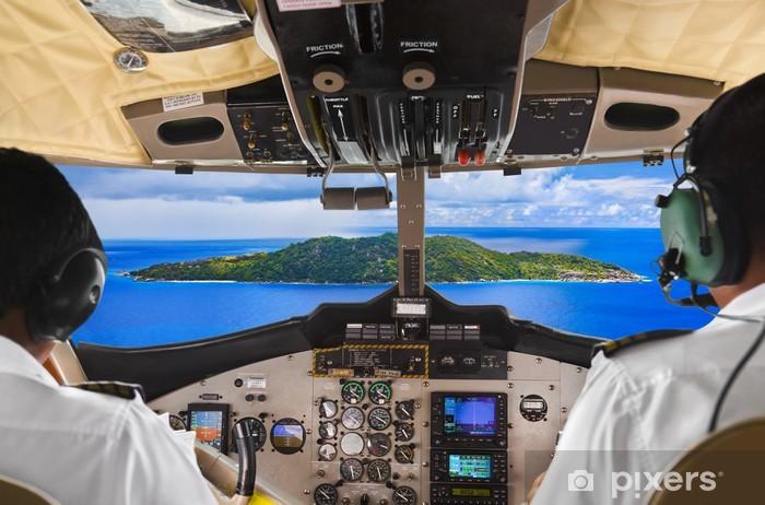 Fototapeta winylowa Piloci w kokpicie samolotu i wyspy - Woda