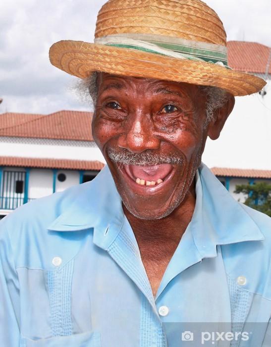Fototapeta winylowa Stary człowiek sympatyczny kubańska słomkowym kapeluszu zrobić śmieszną twarz, Kuba - Ameryka