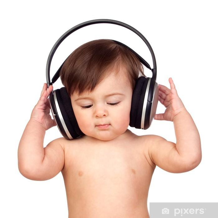Vinyl Fotobehang Schattige baby meisje met een grote koptelefoon - Kunst en Creatie