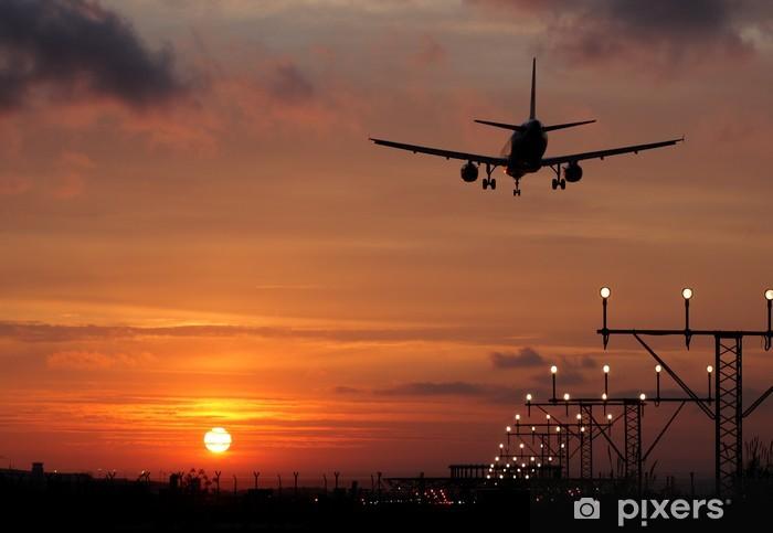 Vinyl Fotobehang Vliegtuig landing in een zonsondergang - Thema's