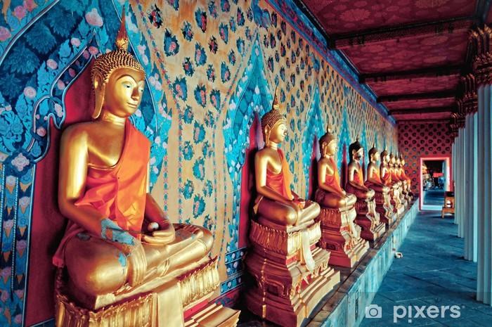 Vinyl Fotobehang Gouden beelden van Boeddha in Wat Arun tempel, Bangkok - Azië