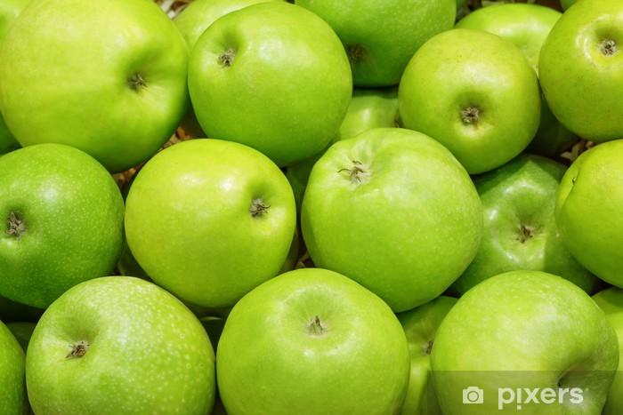 Fototapeta winylowa Zbliżenie z wielu zielonych owoców soczystych jabłek w rynku - Posiłki