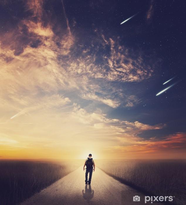 Naklejka Pixerstick Walking Man na zachodzie słońca - Krajobraz wiejski