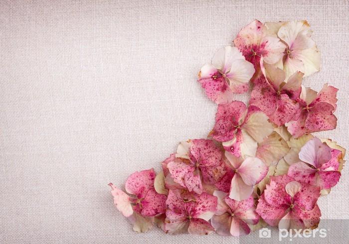 Hydrangea flower petals in bottom right corner on fabric backgro Pixerstick Sticker - Flowers