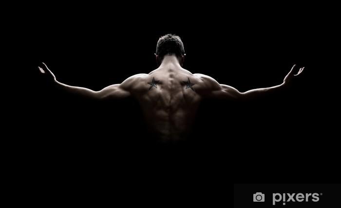 Fototapeta winylowa Tylny widok zdrowego młodego człowieka z rozłożonymi ramionami - Przeznaczenia