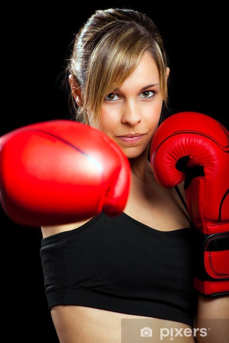 Young woman wearing boxing gloves isolated on black Pixerstick Sticker - Themes