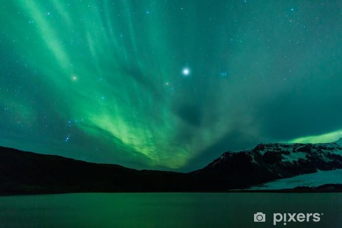 Fototapeta zmywalna Zorza polarna nad laguną w Islandii - Tematy