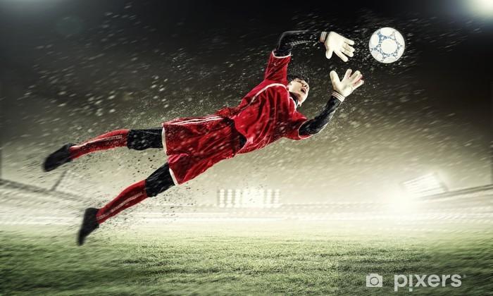 Fototapeta winylowa Bramkarz łapie piłkę - Kobiety