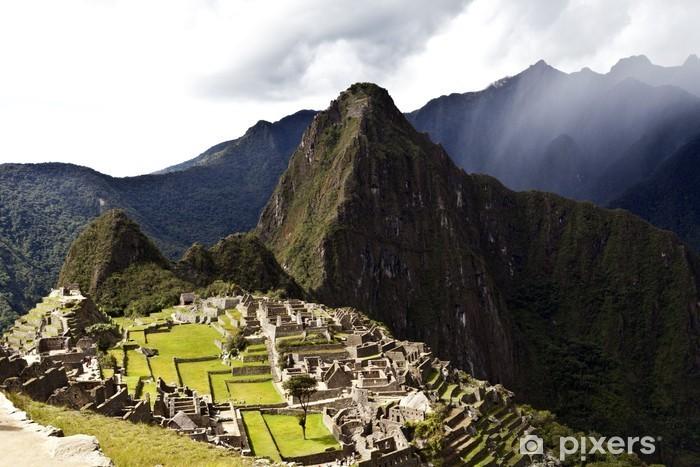 Dark clouds gather above lost Inca town Machu Picchu in Peru Vinyl Wall Mural - Themes