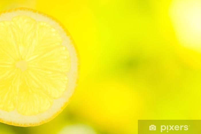 Naklejka Pixerstick Plasterek cytryny na zielonym i żółtym tle - Tematy
