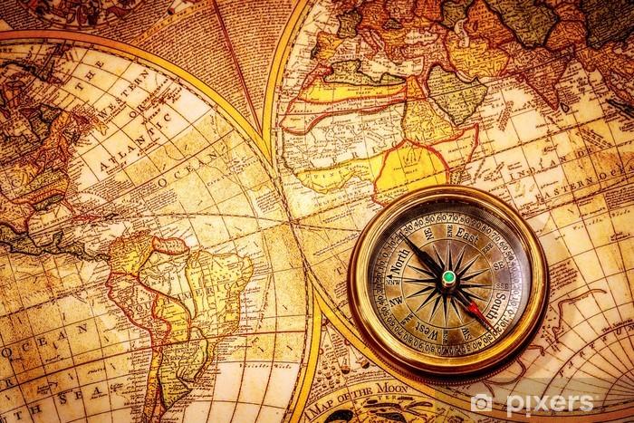 Vintage compass lies on an ancient world map. Pixerstick Sticker - Themes