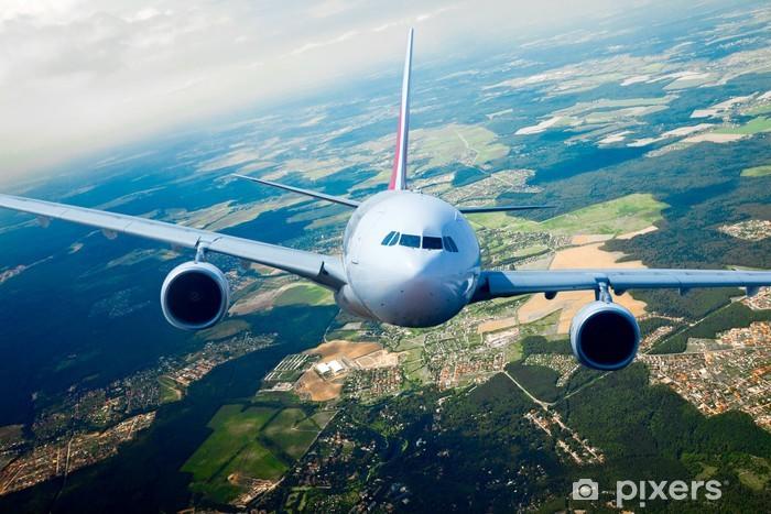 Naklejka Pixerstick Samolot pasażerski na niebie - Tematy