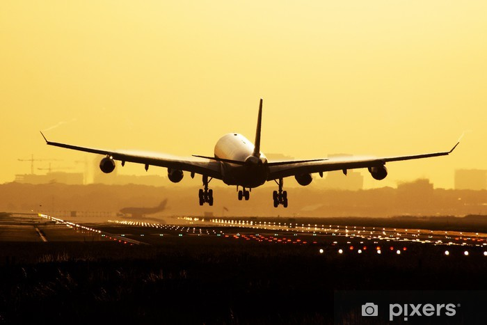 Fototapeta winylowa Lądowanie samolotu sunrise - Tematy
