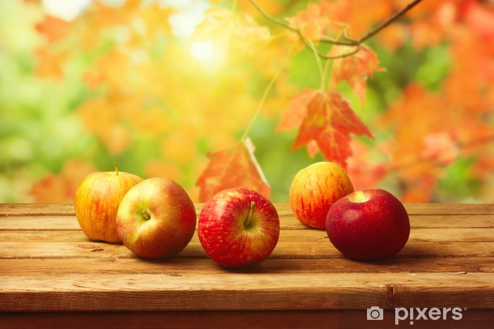 Apples on woodn table over autumn bokeh background Pixerstick Sticker - Themes