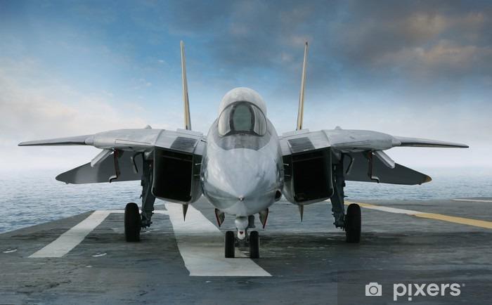 Fototapeta winylowa F-14 myśliwiec odrzutowy na pokładzie lotniskowca patrząc od przodu - Tematy